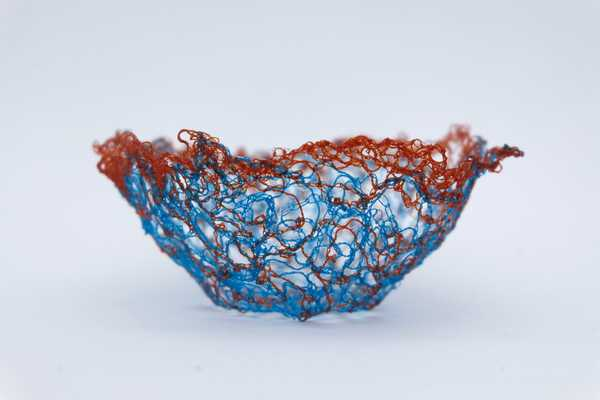 A delicate thread bowl made with water soluble fabric
