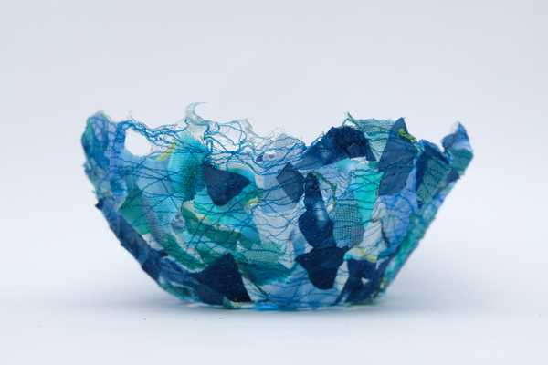 A blue thread bowl made using water soluble fabric